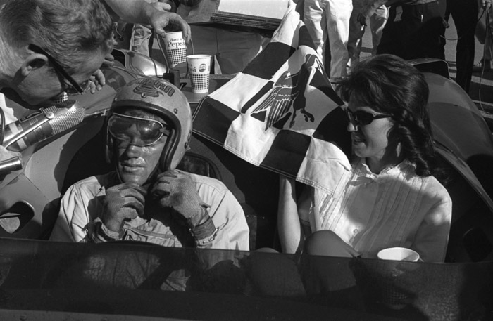 Victory Circle: Dave MacDonald and wife Sherry savor Dave's big win at Riverside in 1963.